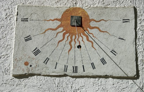 Ancient sundial with signs of the zodiac on white  wall, Germany
